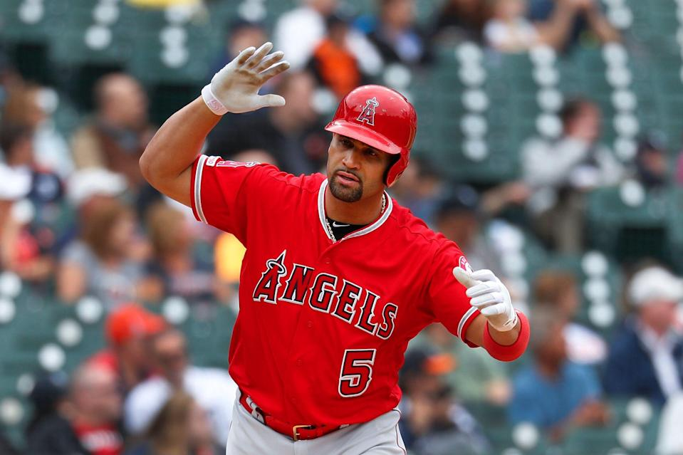 Los Angeles Angels' Albert Pujols tosses his bat after hitting a solo home run in the third inning of a baseball game against the Detroit Tigers in Detroit, Thursday, May 9, 2019. The home run gave Pujols his 2,000 career RBI. (AP Photo/Paul Sancya)