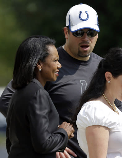 Former United States Secretary of State Condoleezza Rice, left, talks with Indianapolis Colts general manager Ryan Grigson as she visited the NFL football team's practice in Indianapolis, Thursday, Sept. 19, 2013. (AP Photo/Michael Conroy)