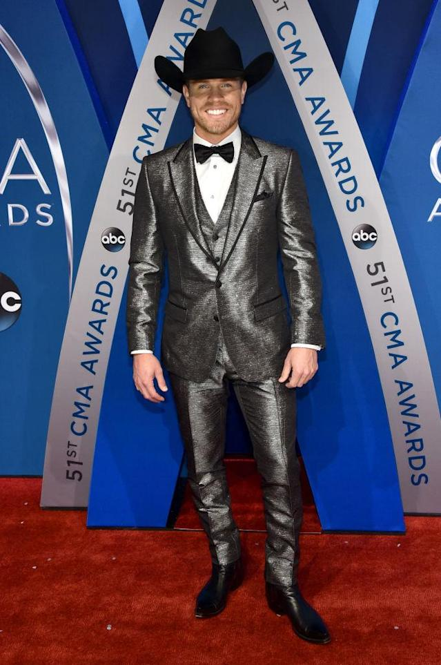 <p>The singer has everyone seeing silver, in a shining monochromatic suit. (Photo: Getty Images) </p>