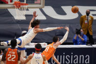 New Orleans Pelicans center Jaxson Hayes tries to block a layup by Phoenix Suns forward Frank Kaminsky (8) during the first half of an NBA basketball game in New Orleans, Friday, Feb. 19, 2021. (AP Photo/Gerald Herbert)