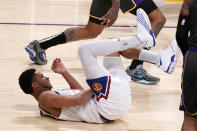 Denver Nuggets guard PJ Dozier writhes on the ground after being injured during the second half of an NBA basketball game against the Los Angeles Lakers Monday, May 3, 2021, in Los Angeles. (AP Photo/Mark J. Terrill)