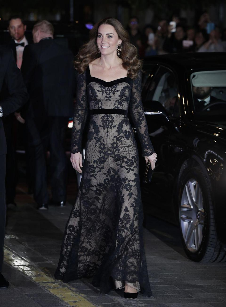 """<p>While <a href=""""https://www.townandcountrymag.com/society/tradition/a29811326/kate-middleton-alexander-mcqueen-royal-variety-performance-photos-2019/"""" rel=""""nofollow noopener"""" target=""""_blank"""" data-ylk=""""slk:attending the annual Royal Variety Performance"""" class=""""link rapid-noclick-resp"""">attending the annual Royal Variety Performance</a>, Kate wore a semi-sheer black lace gown from the brand. She paired the dress with hoop earrings from Erdem.</p>"""