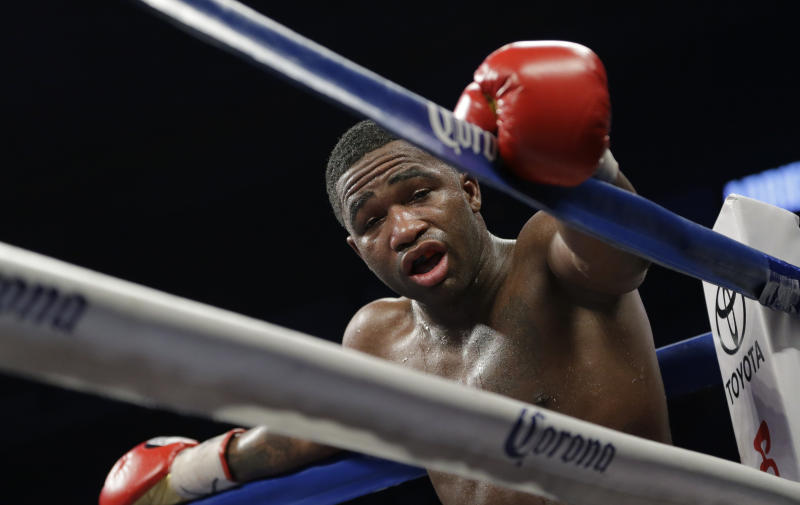 Adrien Broner stands in a neutral corner after he was head butted by Marcos Rene Maidana during an WBA welterweight title bout, Saturday, Dec. 14, 2013, in San Antonio. (AP Photo/Eric Gay)