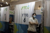 FILE - In this Aug. 15, 2021, file photo, a medical professional waits for his next patient to administer a booster shot for the coronavirus vaccine, at Clalit Health Services, one of Israel's health maintenance organizations, in Jerusalem. Israel is pressing ahead with its aggressive campaign of offering coronavirus boosters to almost anyone over 12 and says its approach was further vindicated by a U.S. decision to give the shots to older patients or those at higher risk. (AP Photo/Maya Alleruzzo, File)