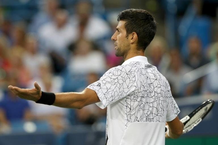 Novak Djokovic of Serbia reacts to a line call while playing Grigor Dimitrov of Bulgaria during the Western & Southern Open, at Lindner Family Tennis Center in Mason, Ohio, on August 16, 2018