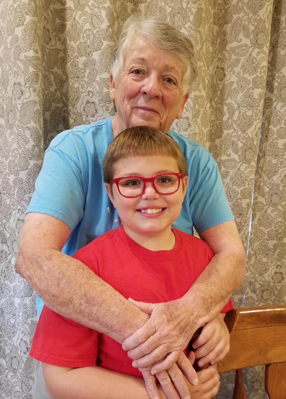 This image released by Renee Fry shows Pat Fry posing with her grandson Liam Fry Hawker. Liam's mother, Renee Fry, CEO and co-founder of an online estate planning business, moved in with her parents just outside State College, Pa, so Pat, a retired eighth-grade science teacher, could oversee Liam's online schooling. (Renee Fry via AP)