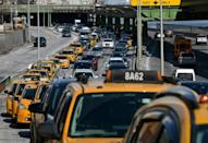 Yellow cabs on their way to block New York's Brooklyn Bridge to demand the city helps with declining fares on February 10, 2021