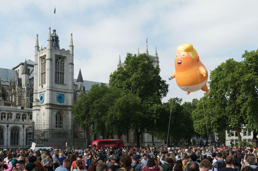 "<p>Donald Trump just touched down in the UK, and protests, including the flying of an orange blimp depicting Trump as a crying baby, have been planned for the duration of his visit. The President's itinerary appears to have been scheduled with the demonstrations in mind, as he will be avoiding the capital as much as possible. Instead, he'll have tea with the Queen at <a rel=""nofollow"" href=""https://www.townandcountrymag.com/leisure/travel-guide/a20673535/travel-guide-windsor/"">Windsor Castle</a>, will tour Blenheim Palace, the 18th-century home where Winston Churchill grew up, and will attend an event at Chequers, the Prime Minister's official country residence. </p><p>Keep reading for more photos of the protests. </p>"