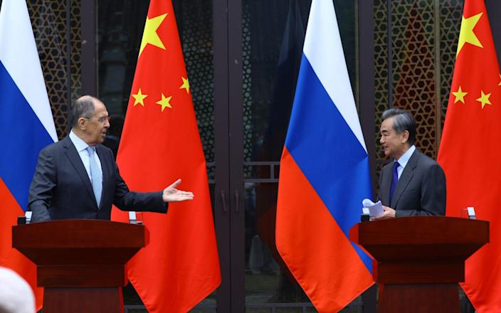 Russian Foreign Minister Sergei Lavrov, left, held talks with his Chinese counterpart, Wang Yi, on Tuesday - Russian Foreign Ministry Handout via Reuters/Russian Foreign Ministry Handout via Reuters