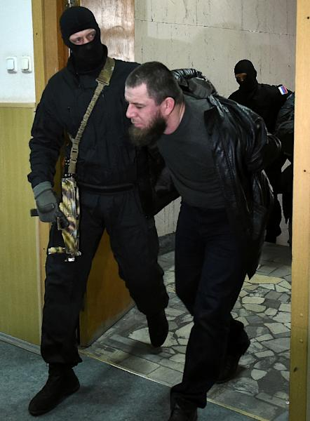Russian police escort Tamerlan Eskerkhanov -- one of five suspects in the killing of Boris Nemtsov -- into a courthouse in Moscow, on March 8, 2015 (AFP Photo/Dmitry Serebryakov)