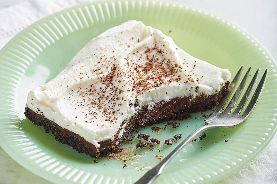 """Made in a sheet pan, this is simply chocolate cream pie squared. <a href=""""https://www.epicurious.com/recipes/food/views/chocolate-cream-pie-squares?mbid=synd_yahoo_rss"""" rel=""""nofollow noopener"""" target=""""_blank"""" data-ylk=""""slk:See recipe."""" class=""""link rapid-noclick-resp"""">See recipe.</a>"""