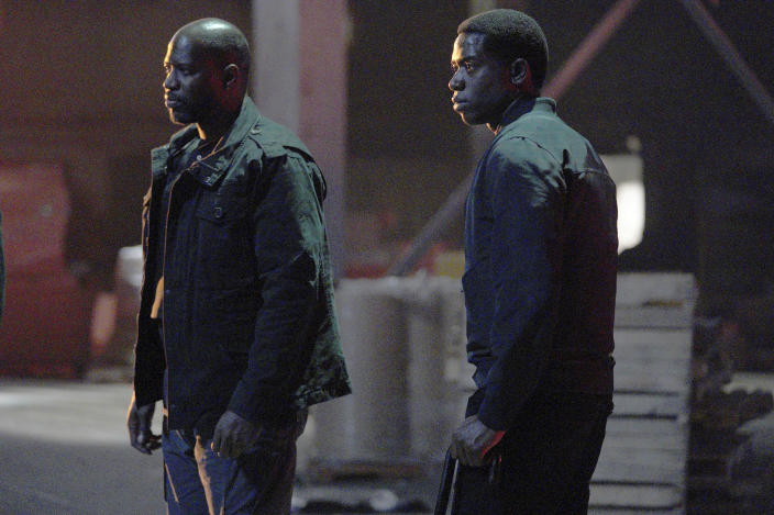 """This image released by FX shows Kwame Patterson as Lurp, left, and Damson Idris as Franklin Saint in a scene from """"Snowfall."""" Season four premiers on FX on Wednesday, and Thursday on FX on Hulu. (Byron Cohen/FX via AP)"""