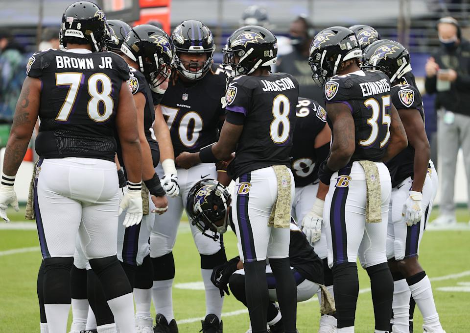 BALTIMORE, MARYLAND - NOVEMBER 22:  Lamar Jackson #8 of the Baltimore Ravens call a huddle against the Tennessee Titans  during the game at M&T Bank Stadium on November 22, 2020 in Baltimore, Maryland. (Photo by Patrick Smith/Getty Images)