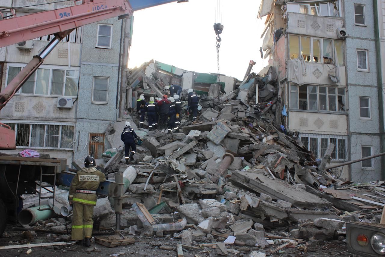 In this photo distributed by Astrakhan branch of the Ministry for Emergency Situations, Emergency Situations Ministry rescuers inspect debris of an apartment building after an explosion on Monday morning, Feb. 27, 2012, in Astrakhan, Russia. Such gas explosions are frequent in Russia.(AP Photo/ Astrakhan Branch, Ministry of Emergency Situations Press Service)