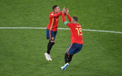 Lucas Vazquez and Sergio Ramos celebrate after the referee used VAR to overrule the offside call on Iago Aspas' equaliser - Credit: OZAN KOSE/AFP/Getty Images