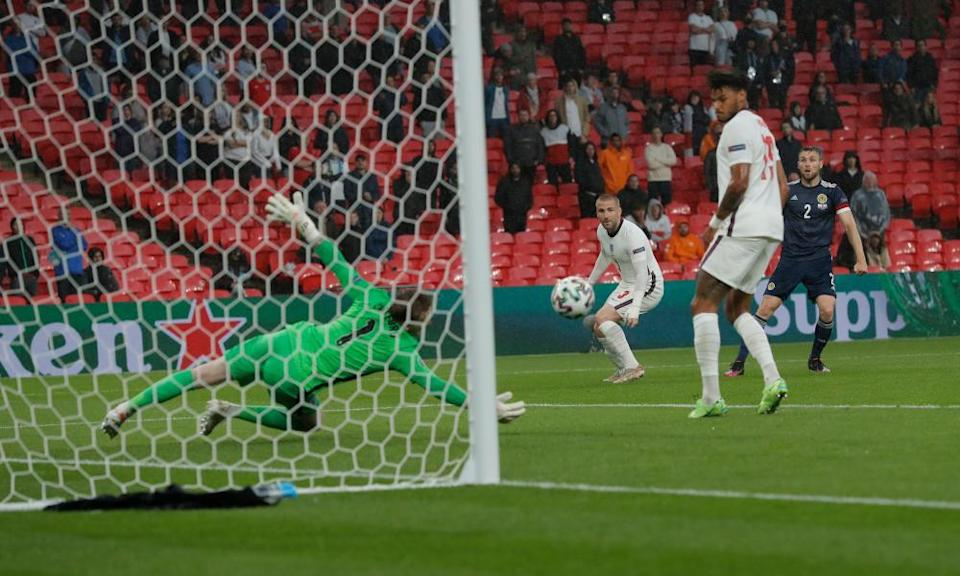Jordan Pickford saves well from Stephen O'Donnell in the first half at Wembley
