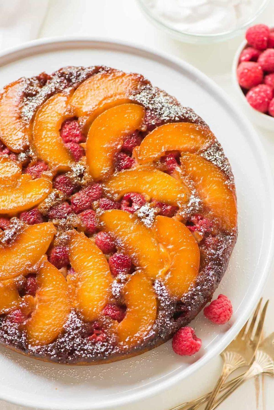 """<p>Upside-down cake doesn't have to be made with pineapple and cherries. In fact, this peach-raspberry version might actually knock the original flavors out of first place.<br></p><p><strong>Get the recipe at <a href=""""https://www.wellplated.com/peach-upside-down-cake/"""" rel=""""nofollow noopener"""" target=""""_blank"""" data-ylk=""""slk:Well Plated by Erin"""" class=""""link rapid-noclick-resp"""">Well Plated by Erin</a>.</strong></p><p><a class=""""link rapid-noclick-resp"""" href=""""https://go.redirectingat.com?id=74968X1596630&url=https%3A%2F%2Fwww.walmart.com%2Fsearch%2F%3Fquery%3Dpioneer%2Bwoman%2Bdishes&sref=https%3A%2F%2Fwww.thepioneerwoman.com%2Ffood-cooking%2Frecipes%2Fg36382592%2Fpeach-desserts%2F"""" rel=""""nofollow noopener"""" target=""""_blank"""" data-ylk=""""slk:SHOP DISHES"""">SHOP DISHES</a></p>"""