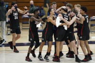 Gonzaga players celebrate after forward Anton Watson (22) dunked during the second half of the team's NCAA college basketball game against Pepperdine on Saturday, Jan. 30, 2021, in Malibu, Calif. (AP Photo/Ashley Landis)