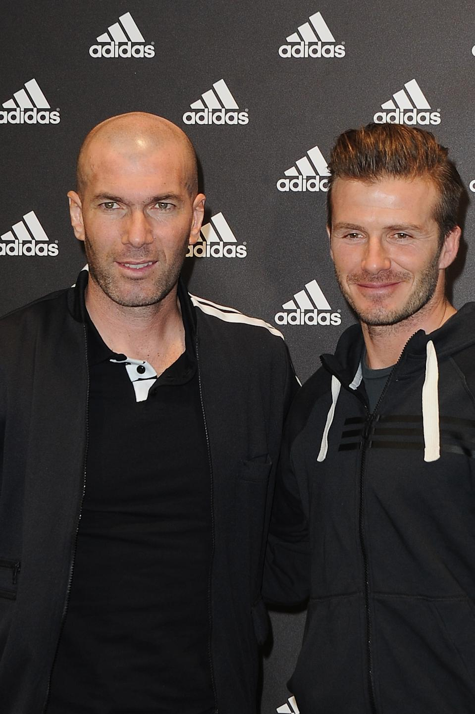 PARIS, FRANCE - FEBRUARY 28: David Beckham and Zinedine Zidane attend an autograph session at adidas Performance Store Champs-Elysees on February 28, 2013 in Paris, France.  (Photo by Pascal Le Segretain/WireImage)