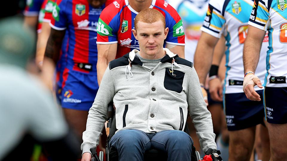 Alex McKinnon is seen here in a wheelchair before a Newcastle Knights match.