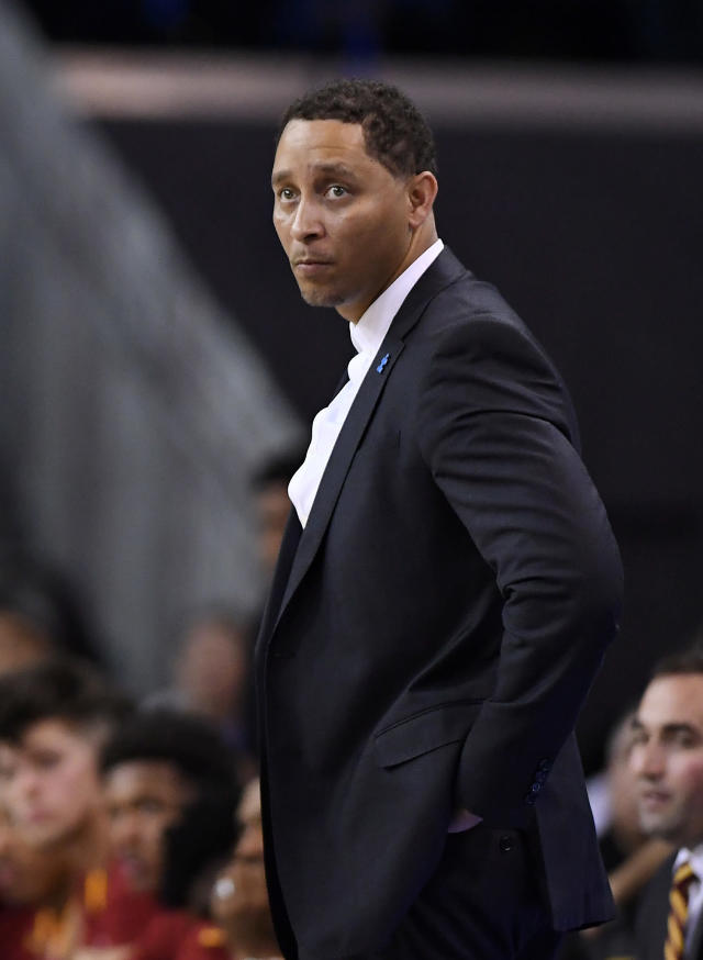 Southern California assistant coach Tony Bland stands on the court during the second half of an NCAA college basketball game against UCLA, Saturday, Feb. 18, 2017, in Los Angeles. Bland along with four other coaches, were identified in court papers and are among 10 people facing federal charges in Manhattan federal court, Tuesday, Sept. 26, 2017, in a wide probe of fraud and corruption in the NCAA, authorities said. (AP Photo/Mark J. Terrill)