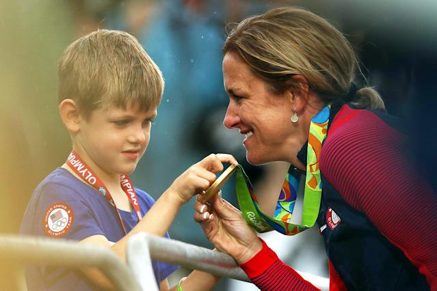 <p>Gold medalist Kristin Armstrong of the United States shows her medal to her son Lucas William Savola after the medal ceremony for the Cycling Road Women's Individual Time Trial on Day 5 of the Rio 2016 Olympic Games at Pontal on August 10, 2016 in Rio de Janeiro, Brazil. (Photo by Bryn Lennon/Getty Images) </p>