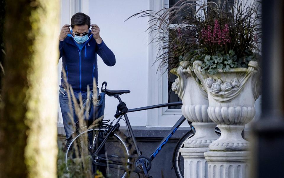 Prime Minister Mark Rutte arrives for an informal meeting on the novel coronavirus, Covid-19, at the Catshuis in The Hague - ROBIN VAN LONKHUIJSEN/AFP