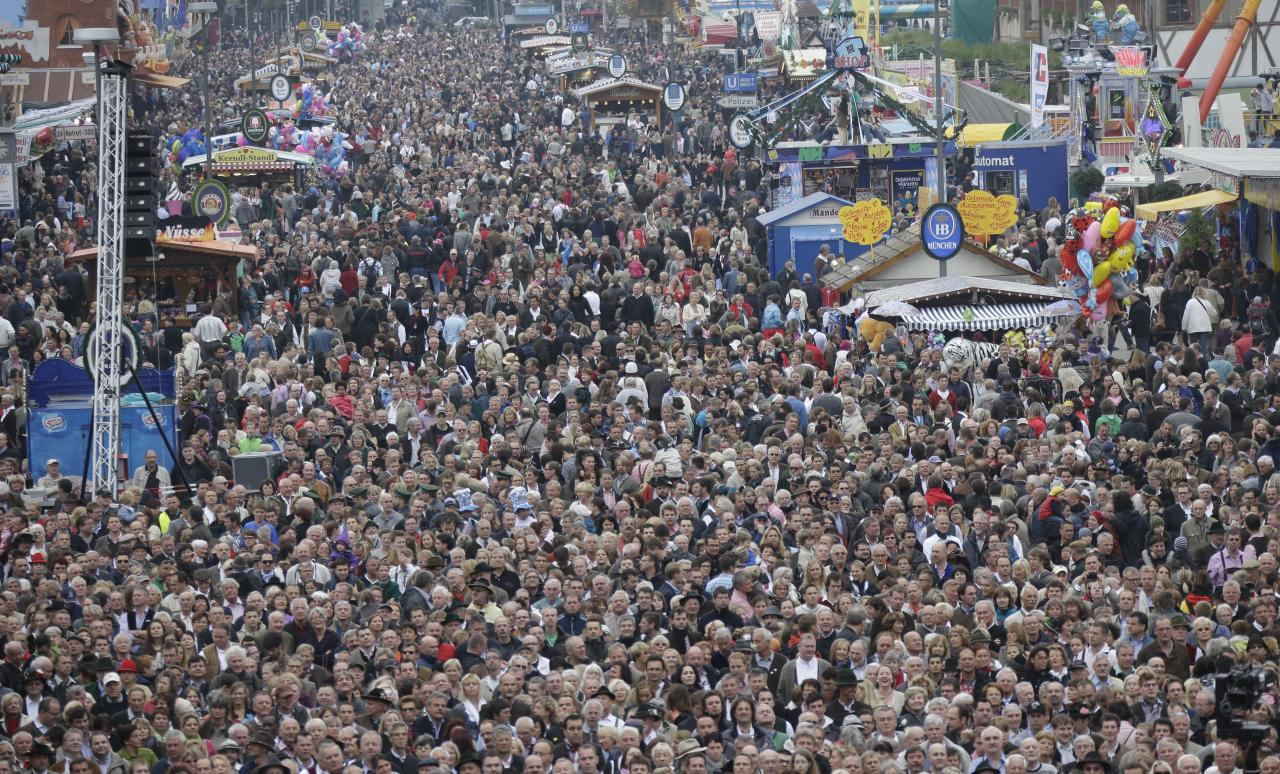 Spectators watch the Oktoberfest orchestra concert at the famous Oktoberfest beer festival in Munich, southern Germany, Sunday, Sept. 30, 2012. The world's largest beer festival, to be held from Sept. 22 to Oct. 7, 2012 will see some million visitors. (AP Photo/Matthias Schrader)