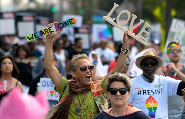 <p>Marchers celebrate during the Los Angeles LGBTQ #ResistMarch, Sunday, June 11, 2017, in West Hollywood, Calif. (Photo: Mark J. Terrill/AP) </p>