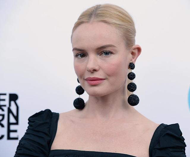 <p>Bosworth attended the 19th Annual Slavery to Freedom Gala in Los Angeles wearing a simple, center-parted updo, spidery lashes, and rosy cheeks and lips. (Photo: Getty Images) </p>