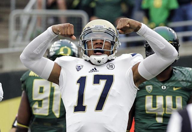 UCLA quarterback Brett Hundley reacts after scoring a touchdown during the first half of an NCAA college football game against Oregon in Eugene, Ore., Saturday, Oct. 26, 2013. (AP Photo/Don Ryan)