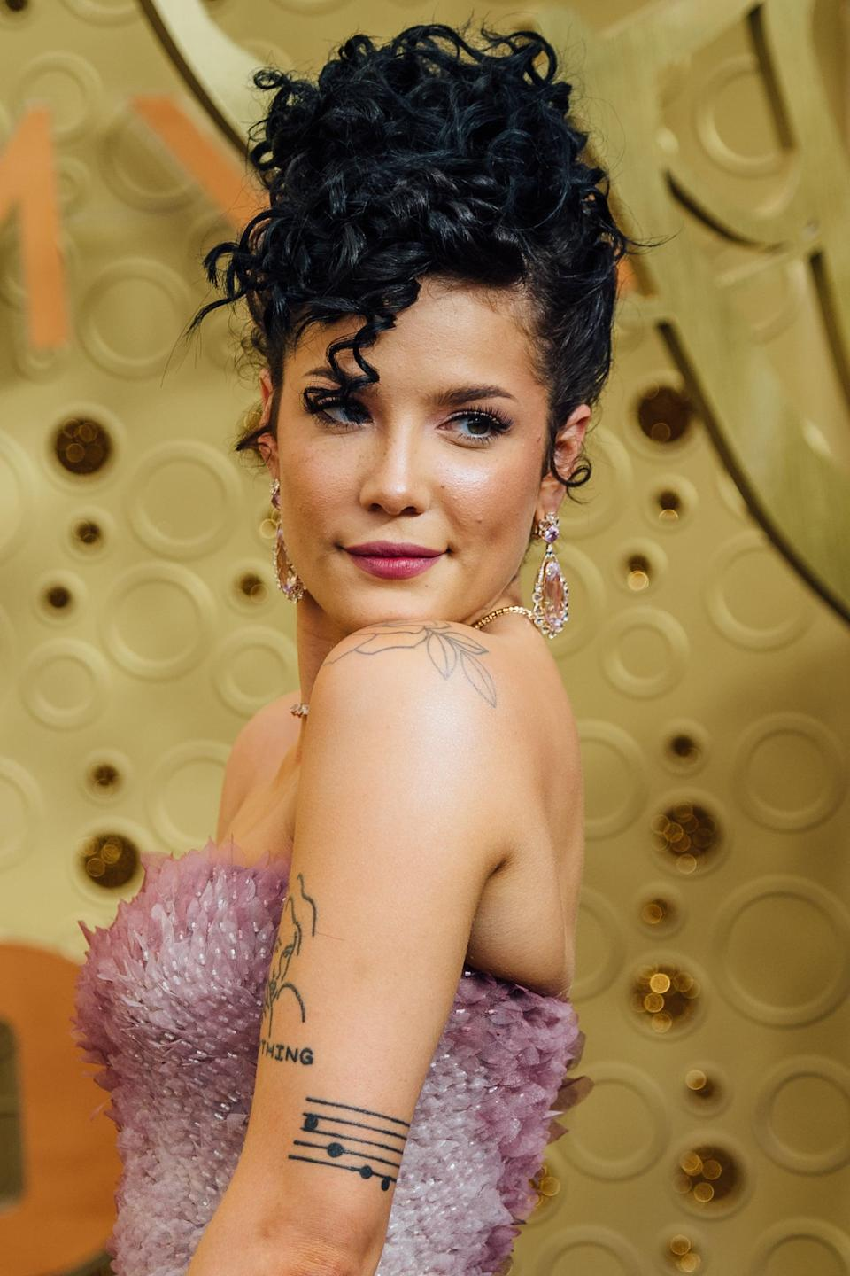 "<p>It's speculated that <a href=""https://www.cosmopolitan.com/entertainment/celebs/g28869337/halsey-tattoos-meaning/?slide=13"" class=""link rapid-noclick-resp"" rel=""nofollow noopener"" target=""_blank"" data-ylk=""slk:the music sheet tattoo"">the music sheet tattoo</a> on the back of Halsey's arm is for producer Lido. </p>"