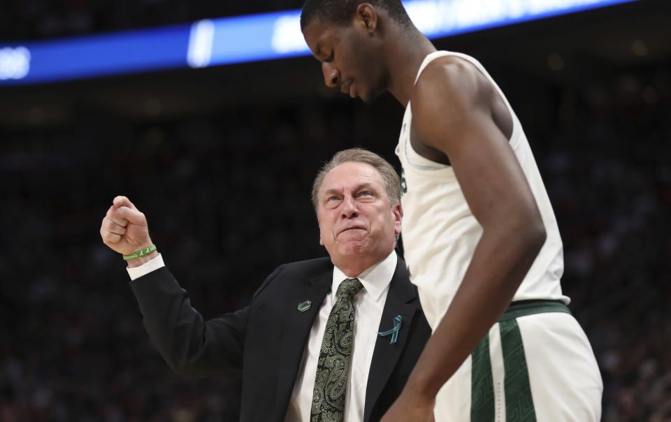 Michigan State head coach Tom Izzo, left, talks with forward Jaren Jackson Jr. during the first half of a second-round game against Syracuse in the NCAA college basketball tournament, Sunday, March 18, 2018, in Detroit. (AP Photo/Carlos Osorio)