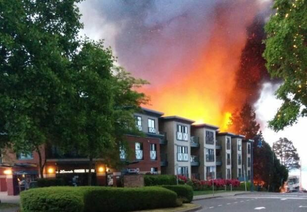 Flames seen shooting out of a four-storey building under construction in White Rock's Five Corners area on Sunday, May 15, 2016. (William Thomas Brooks - image credit)