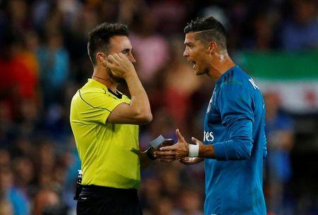 FILE PHOTO: Soccer Football - Barcelona v Real Madrid Spanish Super Cup First Leg - Barcelona, Spain - August 13, 2017   Real Madrid's Cristiano Ronaldo speaks with referee Ricardo de Burgos Bengoetxea after being shown a red card after receiving a second yellow card for simulation   REUTERS/Juan Medina