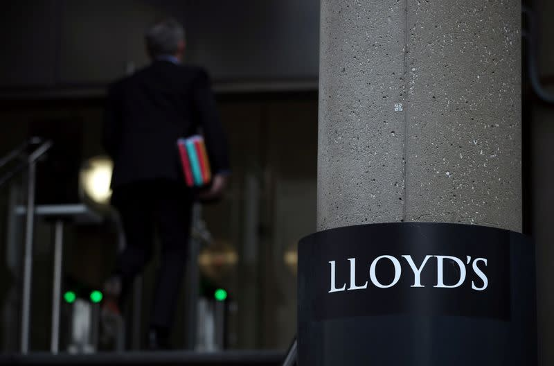 Man enters the Lloyd's of London building in the City of London financial district