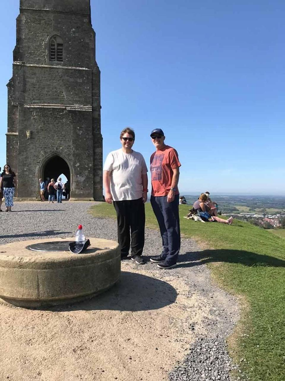 Rhys with his dad at Glastonbury Tor in 2020, about a month into his weight loss. PA REAL LIFE