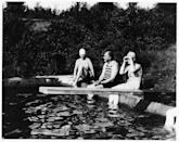 <p>Franklin and Eleanor Roosevelt soak up the sun in their bathing suits, as they sit on the ledge of a swimming pool at their cottage in Val-Kill, New York. </p>