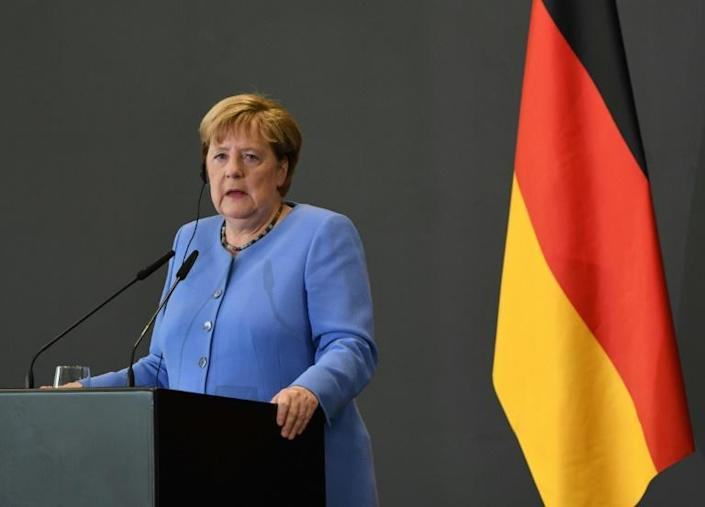 Under Angela Merkel's 16-year rule German growth has bounced back since a difficult decade following unification with the east -- but wealth remains unevenly spread (AFP/Gent SHKULLAKU)