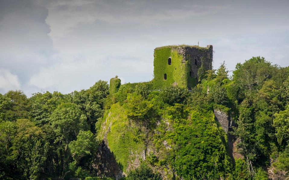 Creeper-covered Dunollie Castle overlooking one of Scotland's temperate rainforests, near Oban - Getty