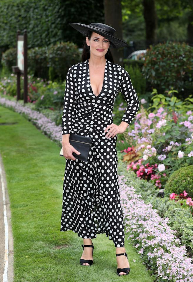 <p>For the second day of racing, television presenter Kirsty Gallacher opted for a polka-dot dress and co-ordinating hat. <em>[Photo: PA]</em> </p>