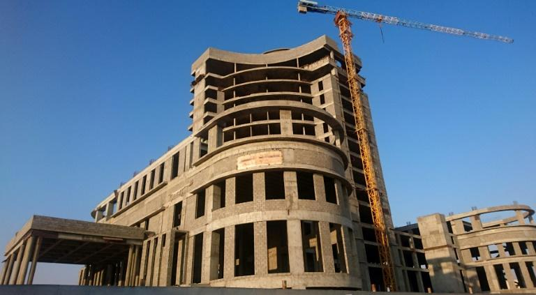 The shells of several Qatari-funded luxury hotels lie abandoned in the Saudi city of Al-Ahsa