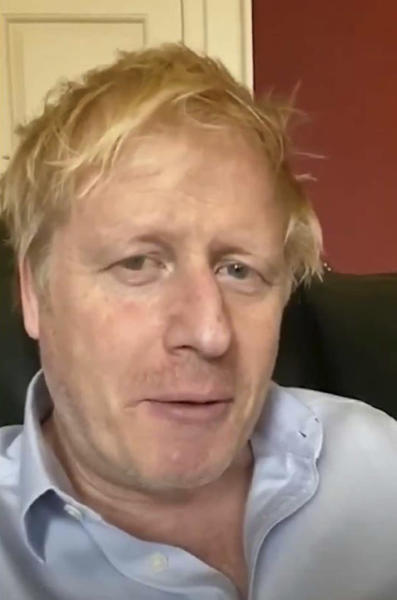 In this image taken from video of the TWITTER/@BorisJohnson, Britain's Prime Minister Boris Johnson speaks from self isolation which he has been in since contracting coronavirus, Friday April 3, 2020. British Prime Minister Boris Johnson has been admitted to a hospital with the coronavirus. Johnson's office says he is being admitted for tests because he still has symptoms 10 days after testing positive for the virus.  (TWITTER/@BorisJohnson via AP)