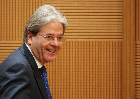 Italy's Prime Minister Paolo Gentiloni arrives to hold a traditional end-year press conference in Rome