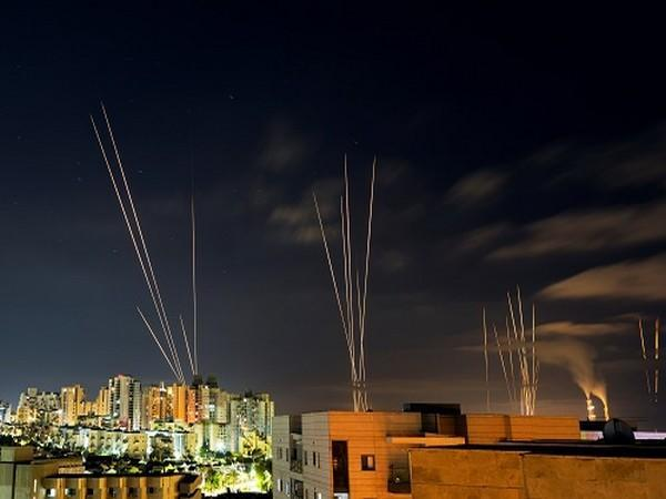 Streaks of light are seen as rockets are launched from the Gaza Strip towards central Israel as seen from Ashkelon, Israel May 16. (Photo Credit: Reuters)