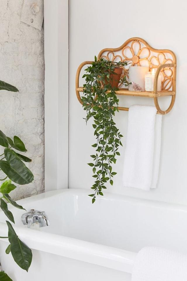 """<p>This <a href=""""https://www.popsugar.com/buy/Rattan-Daisy-Wall-Shelf-558818?p_name=Rattan%20Daisy%20Wall%20Shelf&retailer=urbanoutfitters.com&pid=558818&price=59&evar1=casa%3Aus&evar9=47326714&evar98=https%3A%2F%2Fwww.popsugar.com%2Fhome%2Fphoto-gallery%2F47326714%2Fimage%2F47328046%2FRattan-Daisy-Wall-Shelf&list1=shopping%2Curban%20outfitters%2Corganization%2Cbathrooms%2Chome%20organization%2Chome%20shopping&prop13=api&pdata=1"""" rel=""""nofollow"""" data-shoppable-link=""""1"""" target=""""_blank"""" class=""""ga-track"""" data-ga-category=""""Related"""" data-ga-label=""""https://www.urbanoutfitters.com/shop/rattan-daisy-wall-shelf?category=bathroom-shelving-storage&amp;color=020&amp;type=REGULAR&amp;size=ONE%20SIZE&amp;quantity=1"""" data-ga-action=""""In-Line Links"""">Rattan Daisy Wall Shelf</a> ($59) would look great over your bathtub.</p>"""