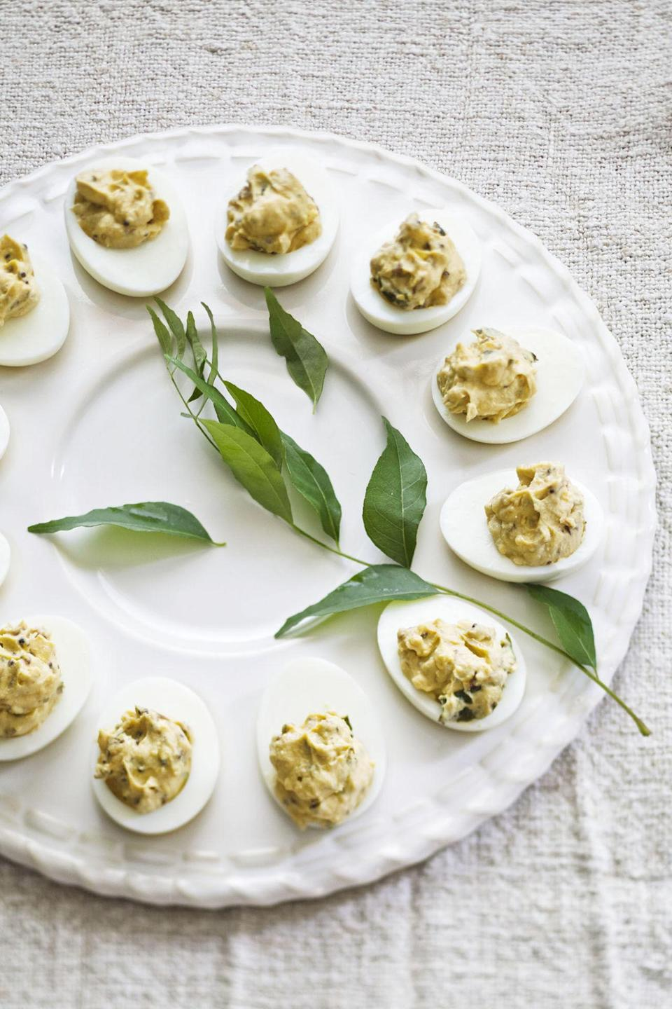 """<p>Bring the heat with these spicy eggs. </p><p><strong><a href=""""http://www.countryliving.com/food-drinks/recipes/a4205/deviled-eggs-cilantro-jalapenos-curry-recipe-clv0712/"""" rel=""""nofollow noopener"""" target=""""_blank"""" data-ylk=""""slk:Get the recipe."""" class=""""link rapid-noclick-resp"""">Get the recipe.</a></strong></p><p><strong>RELATED: </strong><a href=""""http://www.countryliving.com/food-drinks/g1642/easter-brunch-ideas/"""" rel=""""nofollow noopener"""" target=""""_blank"""" data-ylk=""""slk:Recipes for Your Best-Ever Easter Brunch"""" class=""""link rapid-noclick-resp"""">Recipes for Your Best-Ever Easter Brunch</a></p>"""