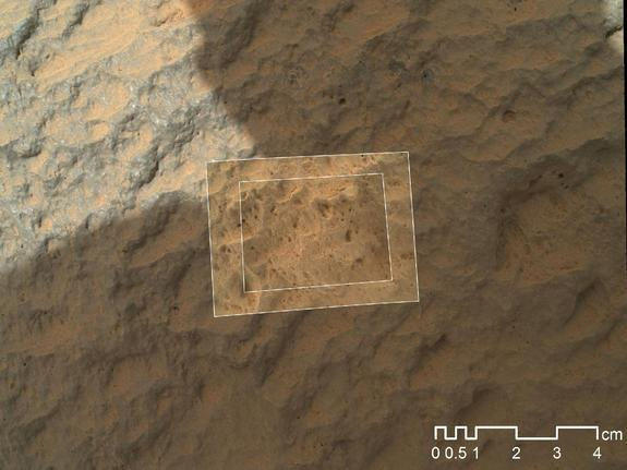 This image combines photographs taken by the Mars Hand Lens Imager (MAHLI) at three different distances from the first Martian rock that NASA's Curiosity rover touched with its arm. The three exposures were taken during the 47th Martian day, or