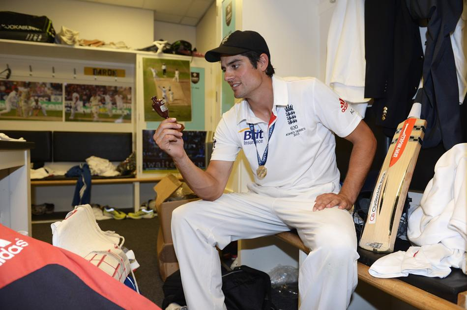 England captain Alastair Cook poses with the Ashes urn in the dressing room after winning the Ashes during day five of the 5th Investec Ashes Test match between England and Australia at the Kia Oval on August 25, 2013 in London, England.  (Photo by Gareth Copley/Getty Images)