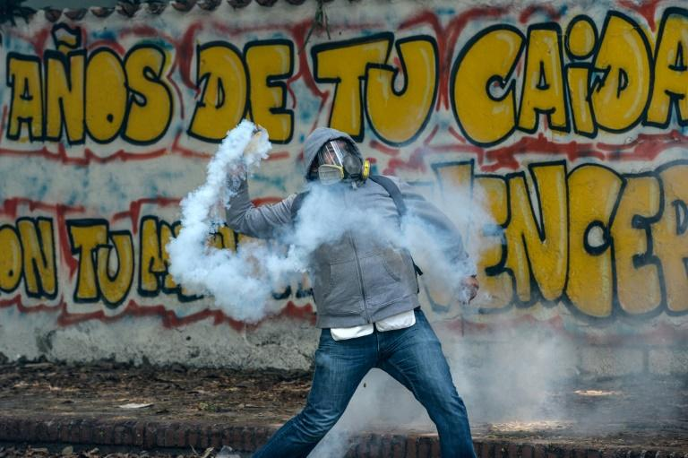 Students clash with riot police in Venezuela where the death toll from anti-government unrest continues to mount
